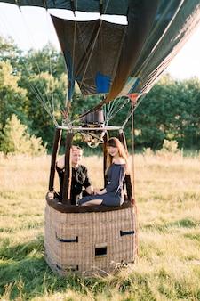 Beautiful romantic couple in hot yellow air balloon