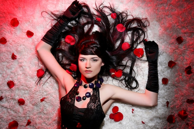Beautiful and romantic woman with red rose