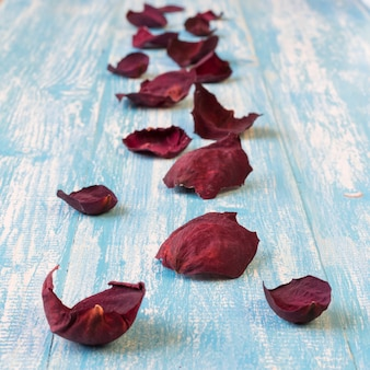 Beautiful rose petals on rustic vintage . old wooden boards.