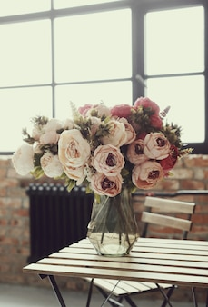 Beautiful roses bouquet on wooden table