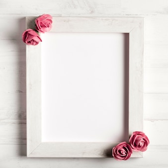Beautiful roses on simple wooden frame