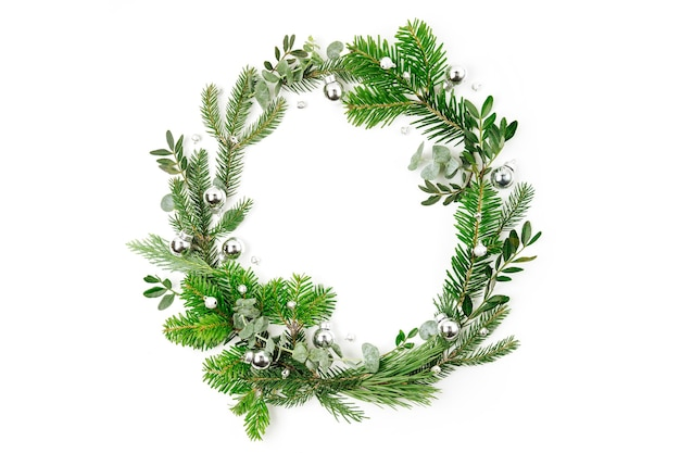 Beautiful round frame of  fir and pine branches with christmas decorations on white background. christmas concept. flat lay, top view