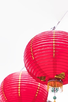 Beautiful round red lantern hanging on old traditional street, concept of chinese lunar new year festival, close up.. Premium Photo