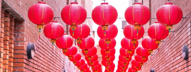 Beautiful round red lantern hanging on old traditional street, concept of chinese lunar new year festival, close up..