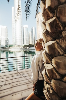 Beautiful russian lady touring around the gulf country on the downtown heart of dubai emirates urban lifestyle.