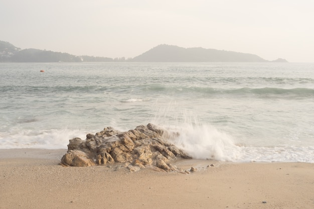 Beautiful sand beach with soft wave hit the rock and sand sea beach