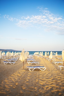 Beautiful sandy beach with sun loungers - vacation, sea, sun