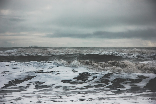 Beautiful scenery of amazing strong ocean waves during misty weather in the countryside