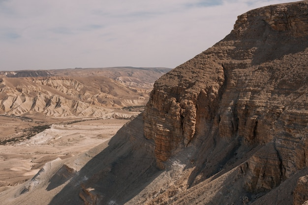 Beautiful scenery of brown badlands under a cloudy sky during daytime