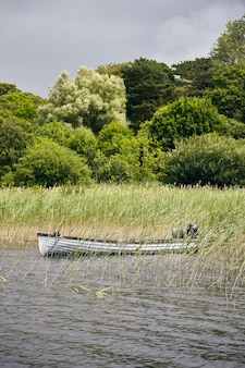Beautiful scenery of parked boat in killarney national park