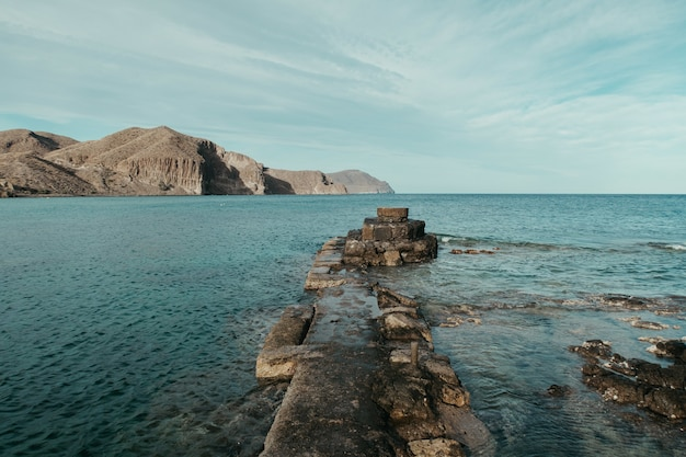 Beautiful scenery of a peaceful sea surrounded by rocky cliffs