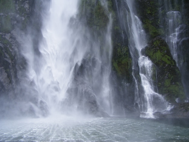 Beautiful scenery of a powerful waterfall in new zealand fjords