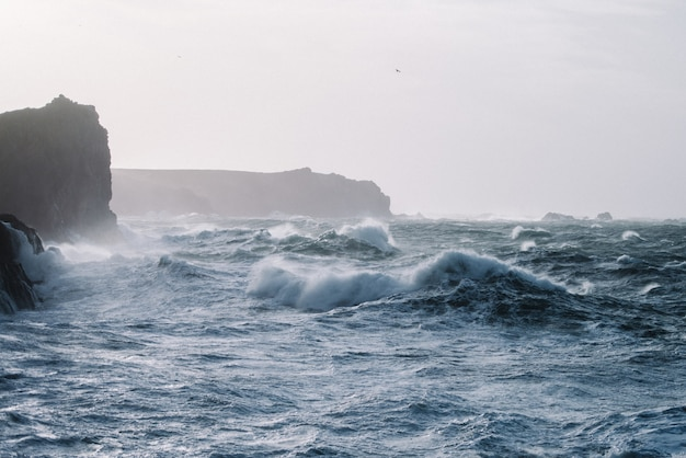 Beautiful scenery of sea waves crashing over rock formations