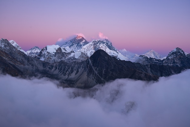 Beautiful scenery of the summit of mount everest covered with snow under the white clouds