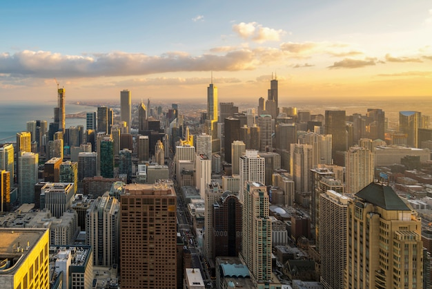 Beautiful scenic view of business district of chicago loop with skyline in evening sunlight. panoramic view aerial top view or drone architecture view of city. famous attraction in chicago, usa.