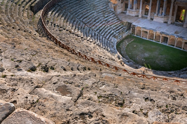 Beautiful scenic view of ruins of ancient amphitheater in hierapolis,turkey. selective focus