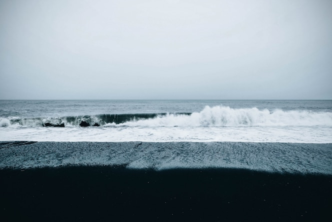 Beautiful scenic view of the sea under a cloudy gloomy sky