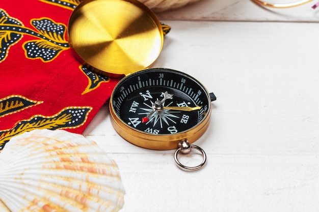 Beautiful sea composition with shells and vintage compass