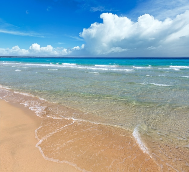Beautiful sea surf, summer seascape view from sandy beach.