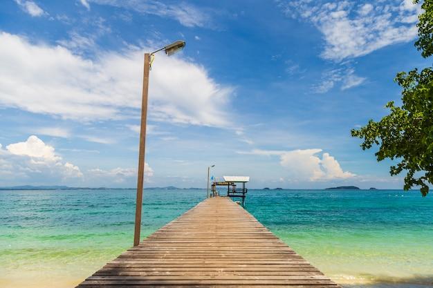 Beautiful seascape picture a wooden bridge to pavillion in the sea.