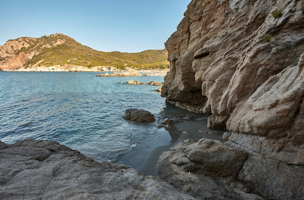 Beautiful seascape with wideangle shot of the exit from a cave with the sea and the shore