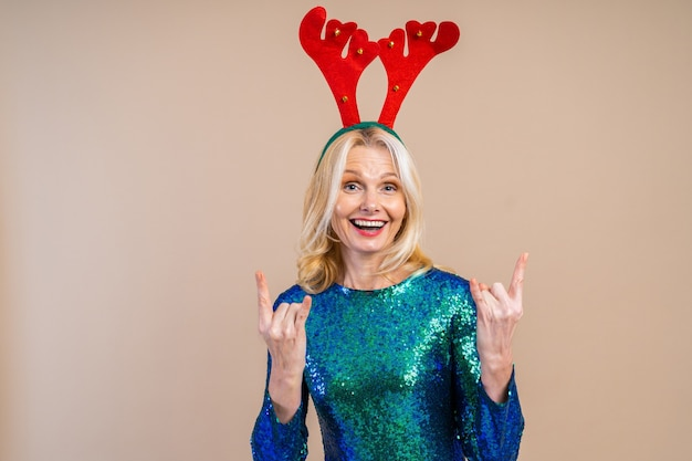 Beautiful senior woman with festive elgant dress having fun at a party