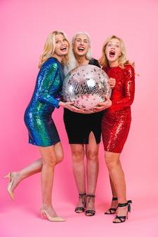 Beautiful senior women with festive elgant dress having fun at a party