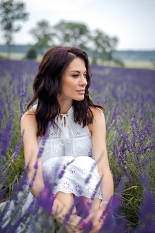 Beautiful sensual young woman on the lavender field