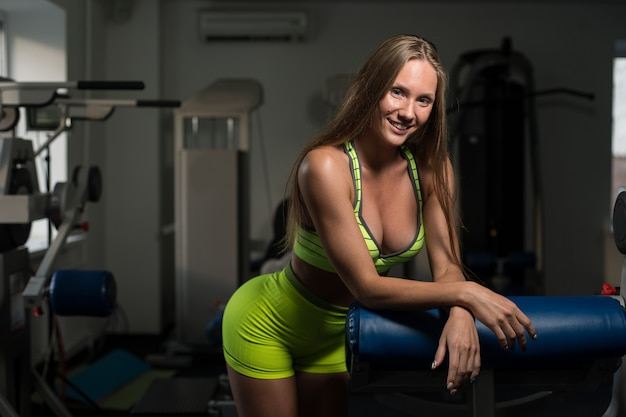 Beautiful sexy athletic muscular young girl. girl is posing after a workout.
