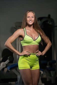 Beautiful sexy athletic muscular young girl.