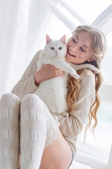 Beautiful sexy blonde sitting with the cat