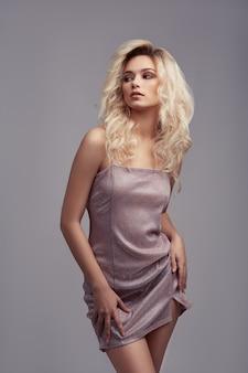 Beautiful sexy girl model posing in dress in the studio