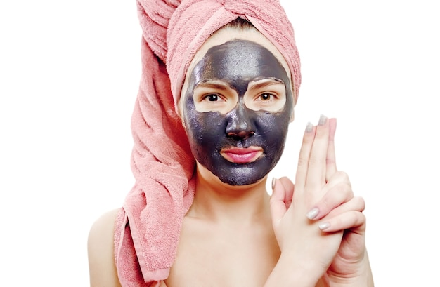 Beautiful sexy girl with black face mask on the white background