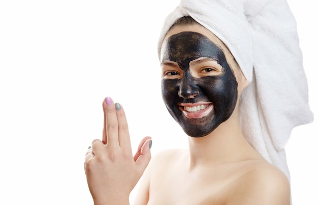 Beautiful sexy girl with black face mask on the white