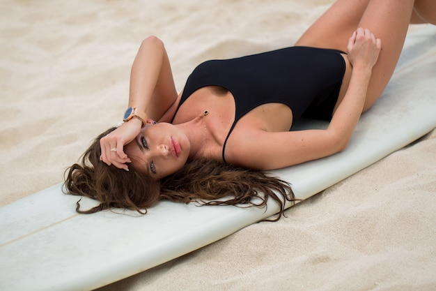 Beautiful sexy surfer girl on the beach