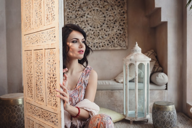 Beautiful sexy woman brunette hair east style arabic morocco furniture