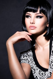 Beautiful sexy woman with short black hair posing