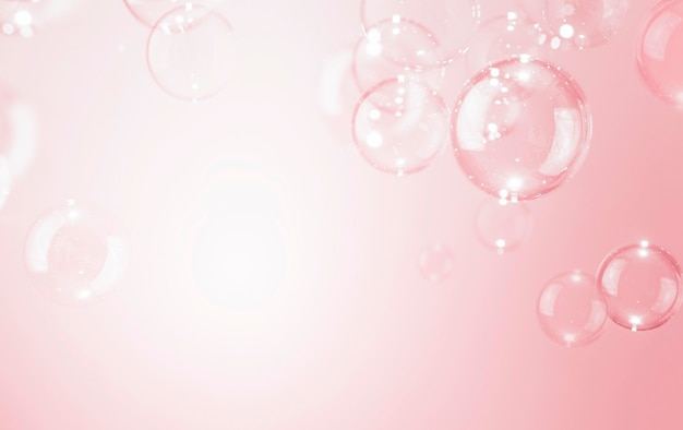 아름 다운 반짝 투명 비누 거품 분홍색 배경.