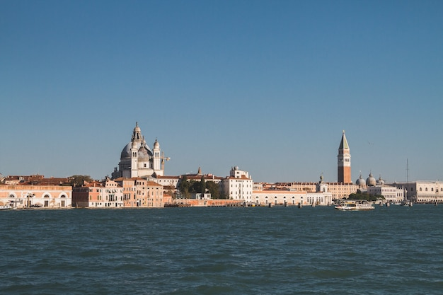 Beautiful shot of buildings in the distance in venice italy canals