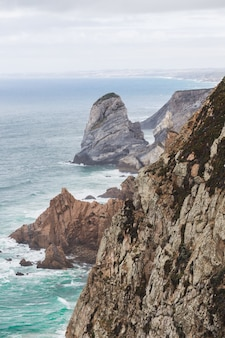 Beautiful shot of cabo da roca during story weather in colares, portugal