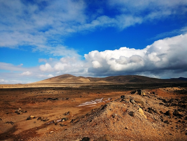 Beautiful shot of clouds and mountains in rural park betancuria fuerteventura, spain