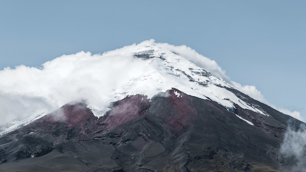 Beautiful shot of the cotopaxi volcano surrounded by clouds in ecuador