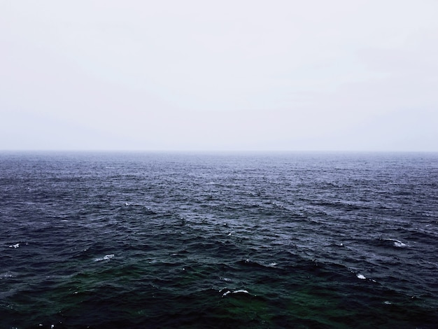 A beautiful shot of an empty sea with a foggy background