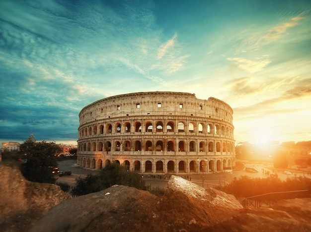 Beautiful shot of the famous roman colosseum amphitheater under the breathtaking sky at sunrise