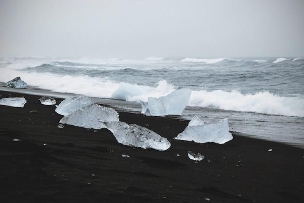 Beautiful shot of frozen icebergs near the shore of the sea