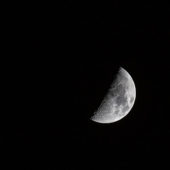 Beautiful shot of a half-moon in the dark sky
