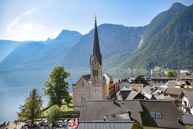 Beautiful shot of hallstatt village in austria surrounded by greenery-covered mountains