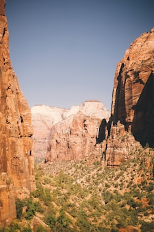 Beautiful shot of high brown cliffs in the canyon