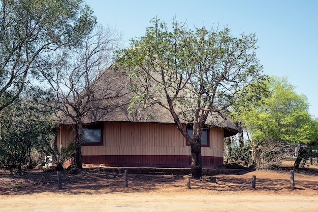 Beautiful shot of a huge african hut with a clear blue sky