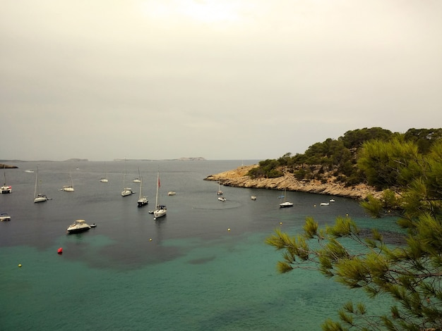 Beautiful shot of the ibiza coast with multiple boats in water